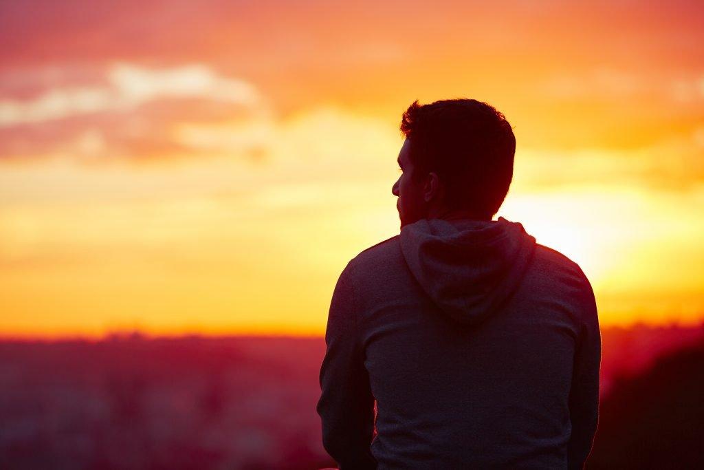 man watching sunset