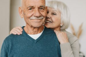 Elderly couple standing together smiling