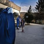Women and children on a street in Kabul in 2010.